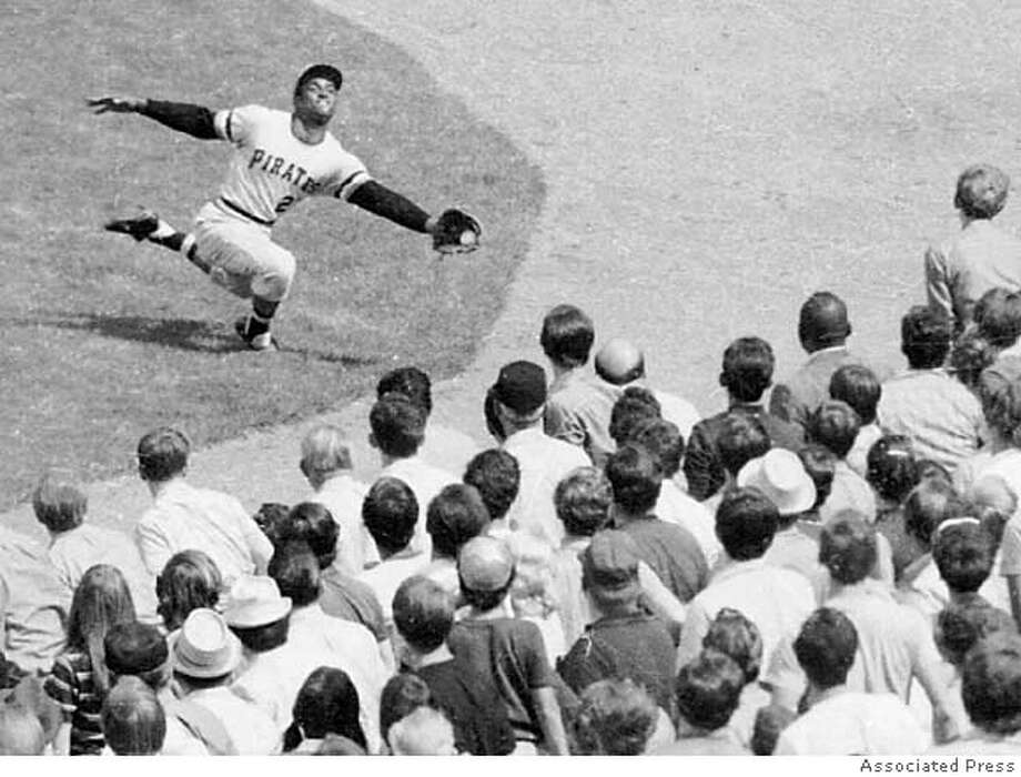 ADVANCE FOR WEEKEND of SEPT. 4-5--FILE--Pittsburgh Pirates' Roberto Clemente robs New York Mets' Cleon Jones of a hit at New York's Shea Stadium, Sept. 21, 1970. As if pennant races and wild card chases aren't tough enough, now baseball wants fans to separate Cochrane from Bench, Cobb from Mays, Ruth from Aaron.(AP Photo) ADVANCE FOR WEEKEND of SEPT. 4-5 Photo: STF