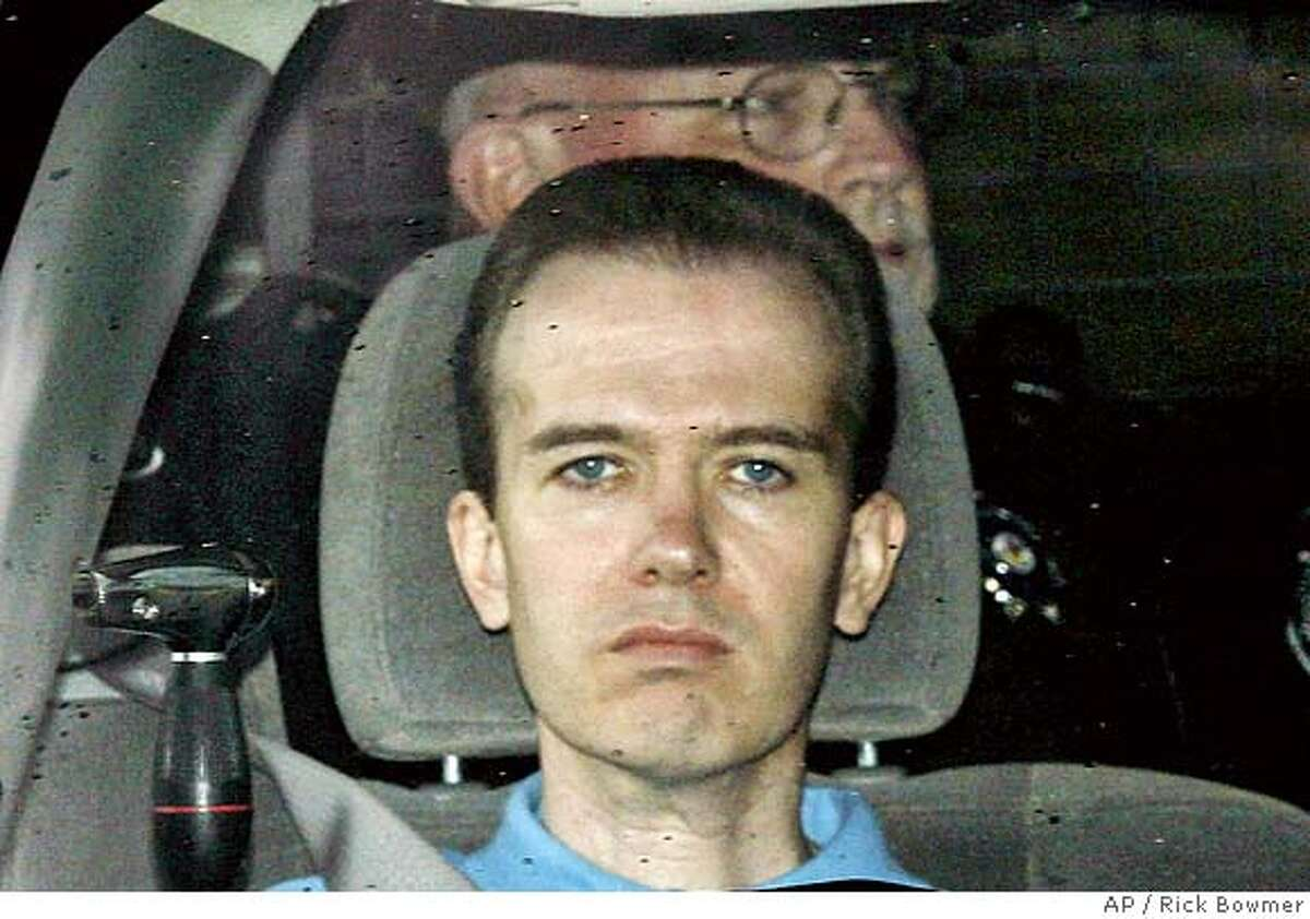 John Mark Karr rides in a police vehicle as he arrives back at the Boulder County Jail in Boulder, Colo., Monday, Aug. 28, 2006. Prosecutors decided not to charge John Mark Karr in the slaying of JonBenet Ramsey, his lawyers said Monday after a TV station reported that the schoolteacher's DNA failed to match genetic material on the 6-year-old girl's body. (AP Photo/Rick Bowmer)