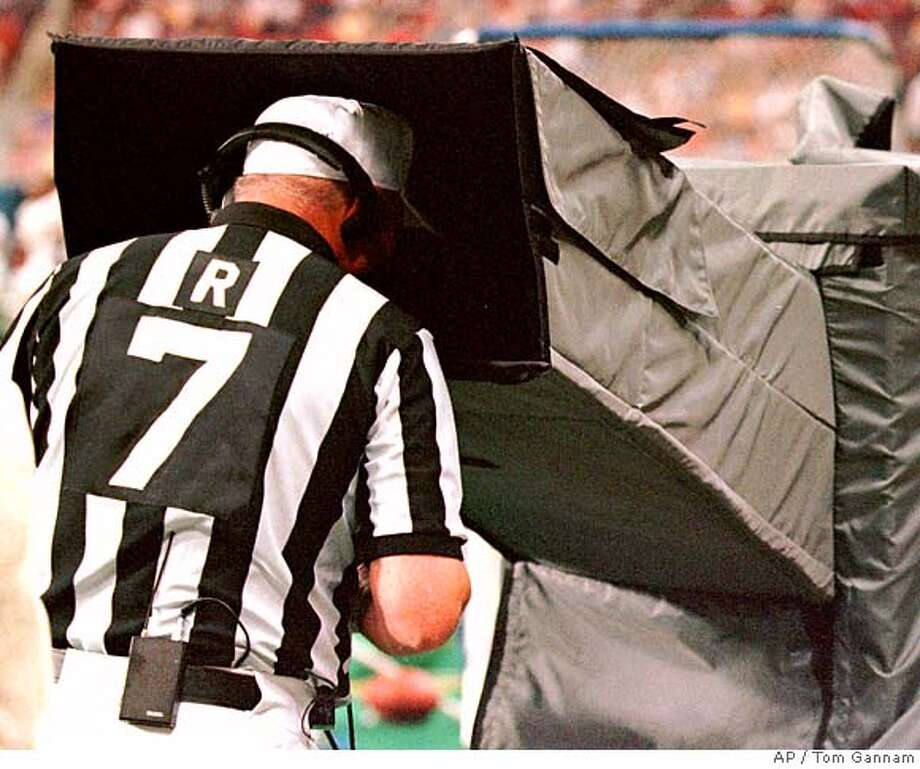 Referee Ron Blum reviews a play during the first quarter of a preseason game between the San Diego Chargers and the St. Louis Rams on Saturday, Aug. 28, 1999, at the Trans World Dome in St. Louis. Instant replay has been reintroduced for this preseason on a trial basis. (AP Photo/Tom Gannam) Photo: TOM GANAM