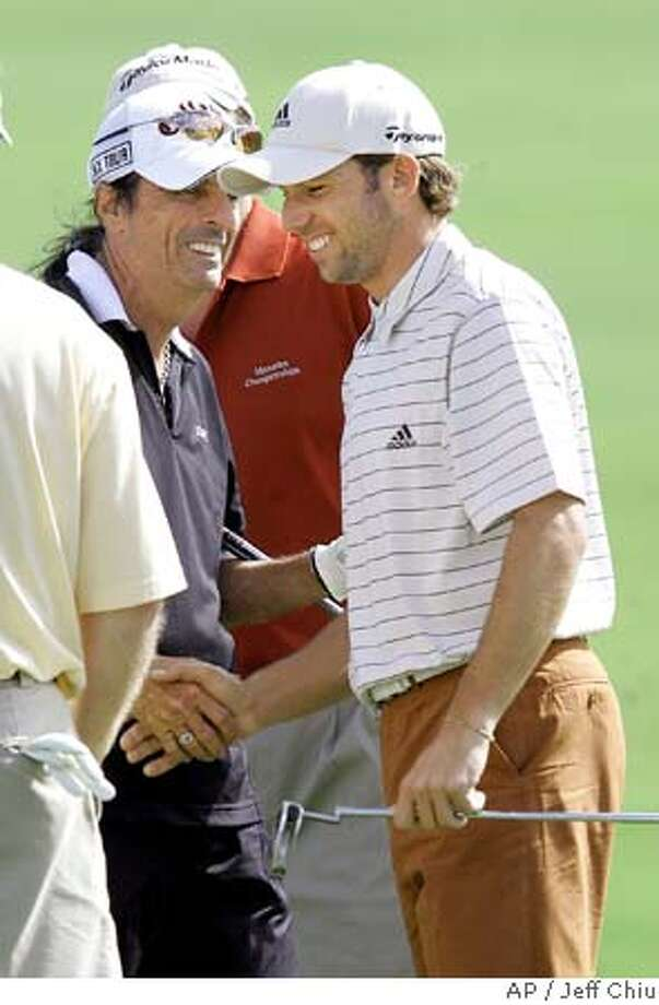 Sergio Garcia, right, from Spain, shakes hands with musician Alice Cooper after their team completed the Mercedes Championships pro-am in Kapalua, Hawaii, Wednesday, Jan. 4, 2006. (AP Photo/Jeff Chiu) Photo: JEFF CHIU