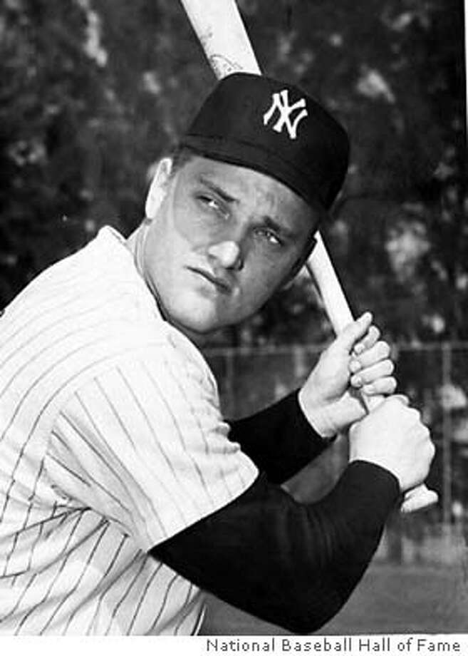 WAS01:SPORT-BASEBALL:COOPERSTOWN,NY,4SEPT98 - 1961 PHOTO - Current single season home run champion New York Yankees Roger Maris is shown in a team head shot in 1961. The chase for Maris' record of 61 home runs in 1961 heads into the weekend with St. Louis Cardinals Mark McGwire with 59 home runs and Chicago Cubs Sammy Sosa with 56. ( ) rc/Photo courtesy National Baseball Hall of Fame REUTERS Photo: HO