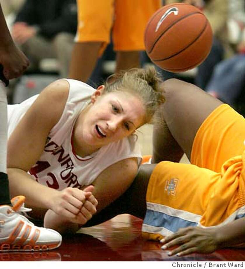Stanfords number one scorer Kristen Newlin with 20 points, was knocked to the floor in the final moments.  Tennessee Lady Volunteers came to Maples Pavilion Sunday afternoon to take on the lady Stanford Cardinal...after a hard fought battle the final was 74-67, Tennessee wins.  12/4/05 Photo: Brant Ward