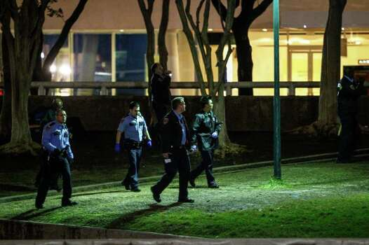 "Houston Police Officers walk through Tranquility Park looking for Occupy Houston participants after police officers moved in and took over the park after sunset on Mayor Annise Parker's orders, Monday, Feb. 13, 2012, in Houston.   The move comes approximately four months after Occupy Houston movement began. ""I told Occupy Houston leaders in January they need to decide the next phase for their effort,"" said Mayor Annise Parker. ""I support their right to free speech and I'm sympathetic to their call for reform of the financial system, but they can't simply continue to occupy a space indefinitely. We have to get the area ready for the spring festivals and that necessitates their leaving.""  ( Michael Paulsen / Houston Chronicle ) Photo: Michael Paulsen / © 2012 Houston Chronicle"