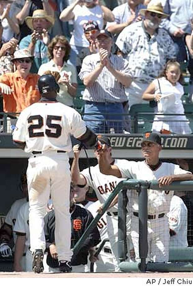 San Francisco Giants' Barry Bonds (25) is congratulated by manager Felipe Alou, right, after hitting his 668th career home run off of Florida Marlins pitcher Brad Penny in the sixth inning in San Francisco on Thursday, April 29, 2004. The Marlins won 4-3. Bonds' home run gave he and his father Bobby Bonds a family total of 1,000. Bonds wanted to play Thursday, so manager Alou rewrote his lineup to include the star slugger. (AP Photo/Jeff Chiu) Photo: JEFF CHIU