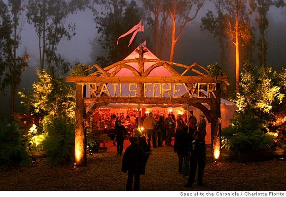"Happy trails: The Julie Haas-designed dinner tent and hand-crafted sign at Golden Gate National Parks Conservancy's ""Trails Forever"" dinner (sponsored by Unilever Lipton) at the Rob Hill Campground in Presidio National Park. Photo by Charlotte Fiorito, special to the Chronicle"