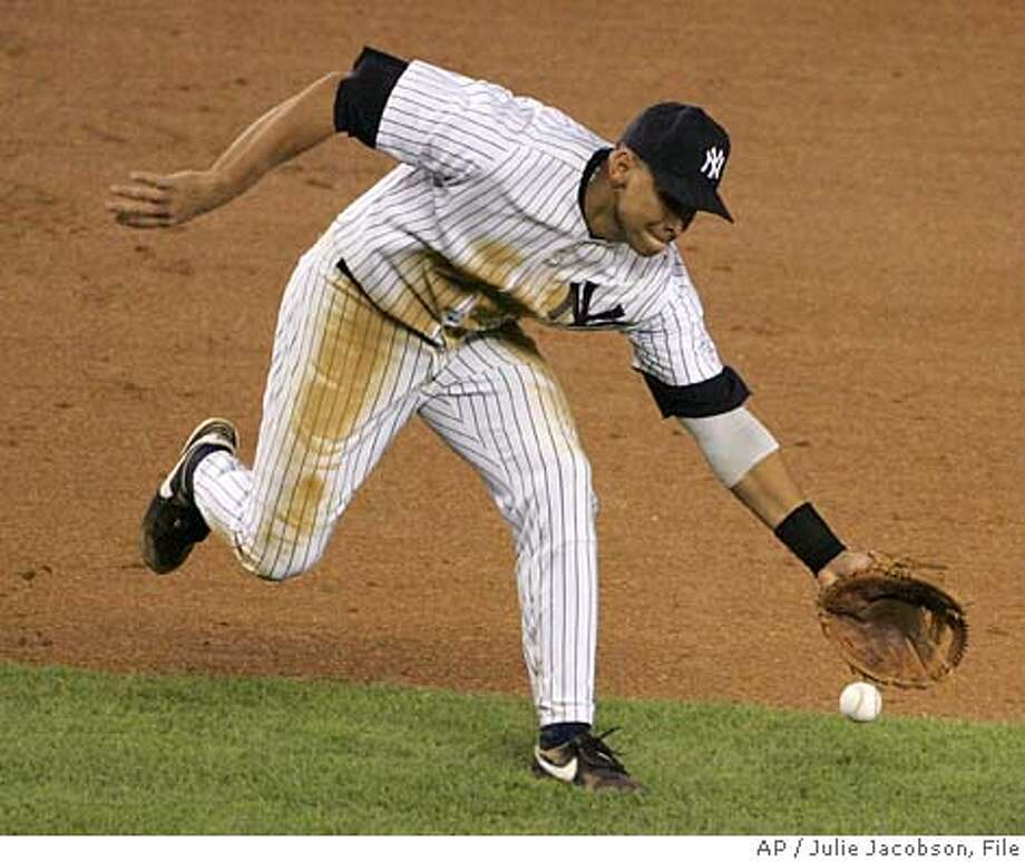 New York Yankees third baseman Alex Rodriguez chases down a ground ball hit by Toronto Blue Jays' Aaron Hill during the eighth inning Friday, Sept. 23, 2005 at Yankee Stadium in New York. Hill was out at first on the play. (AP Photo/Julie Jacobson) Photo: JULIE JACOBSON