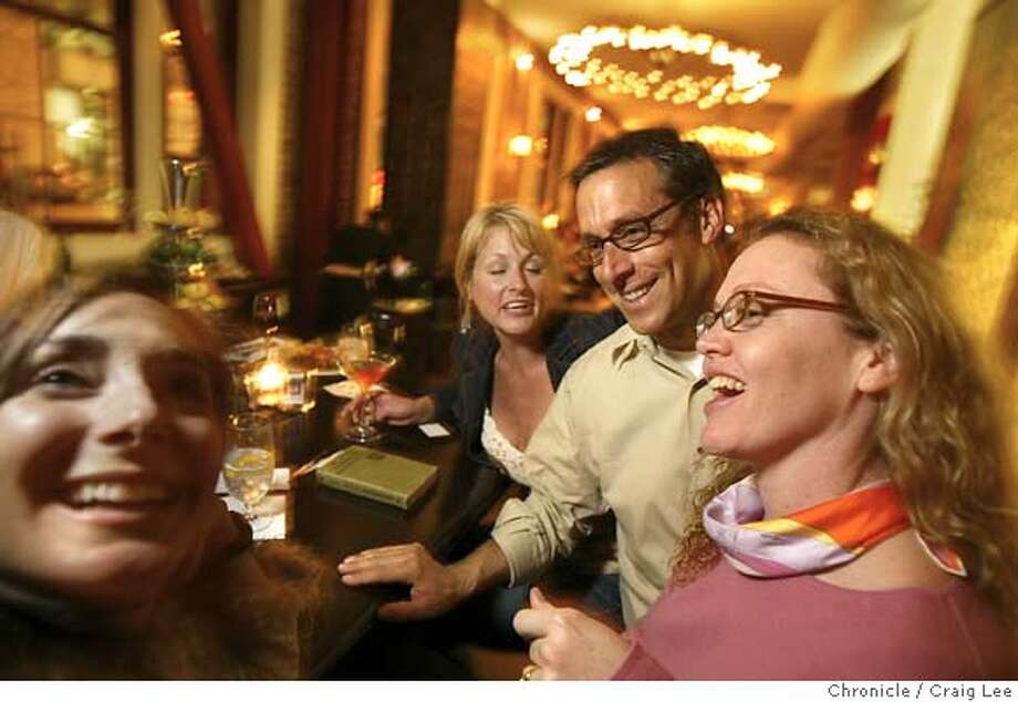 Photo of Doug Washington with some of his customers at the bar, (left-right) Lori Rosenwasser, Amy Carter-Lehr, Doug Washington and Heather Sanchez. Doug Washington is maitre d and owner of Town Hall restaurant in San Francisco. Story on the changing role and type of restaurant maitre d's. Event on 4/8/04 in San Francisco. Craig Lee / The Chronicle Photo: Craig Lee