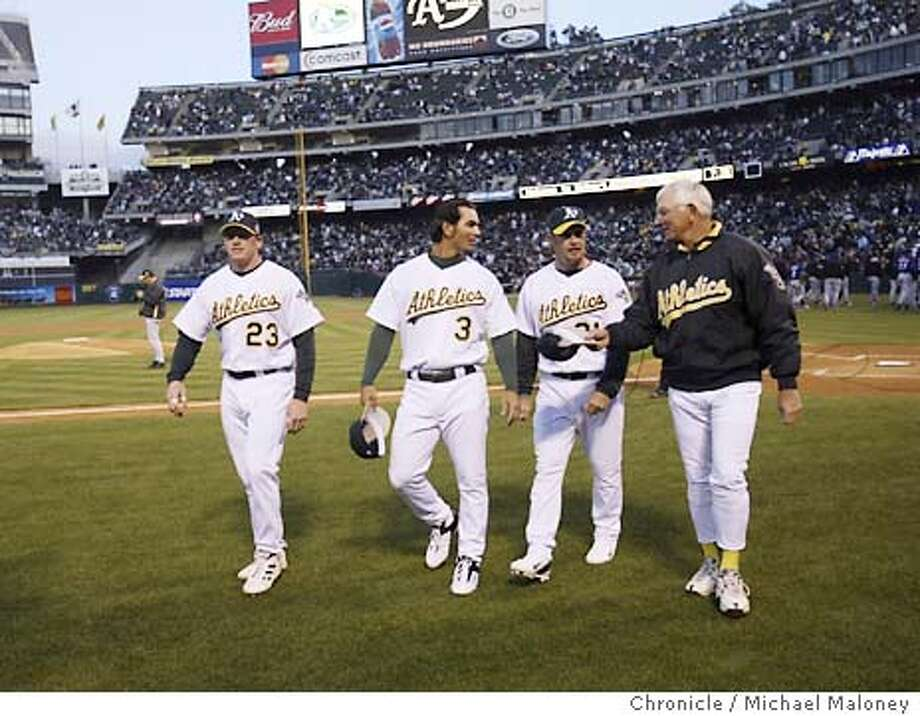 Walking off the field after introductions are from left, A's Bobby Kielty, Eric Chavez, Mark Kotsay and manager Ken Macha  Opening day and home opener for the Oakland Athletics vs Texas Rangers at the Networks Associates Coliseum.  Photo by Michael Maloney / CHRONICLE Photo: Michael Maloney