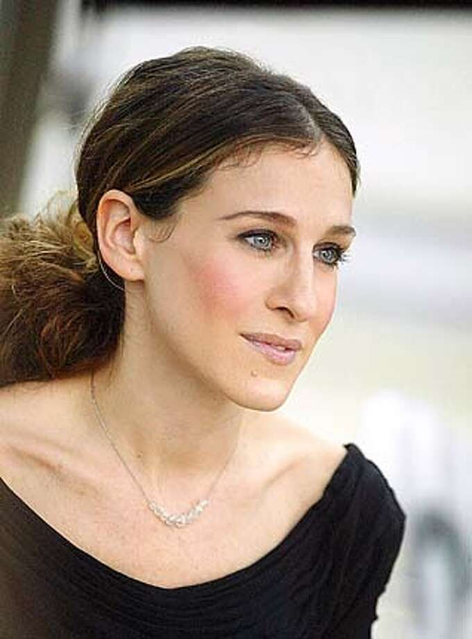 """Sarah Jessica Parker, in the role of Carrie Bradshaw in the finale of HBO Television's """"Sex in the City,"""" wears a necklace in a scene for the series shot in Paris, in this recent but undated publicity photo. When Bradshaw broke her Russian lover's heart and the necklace he'd given her in the finale, the jewelry had a stunt double. The real necklace, consisting of nine diamond beads on a platinum chain and valued at $55,000, remains intact, said New York jeweler Fred Leighton.(AP Photo/HBO Sarah Jessica Parker: Budding role model."""