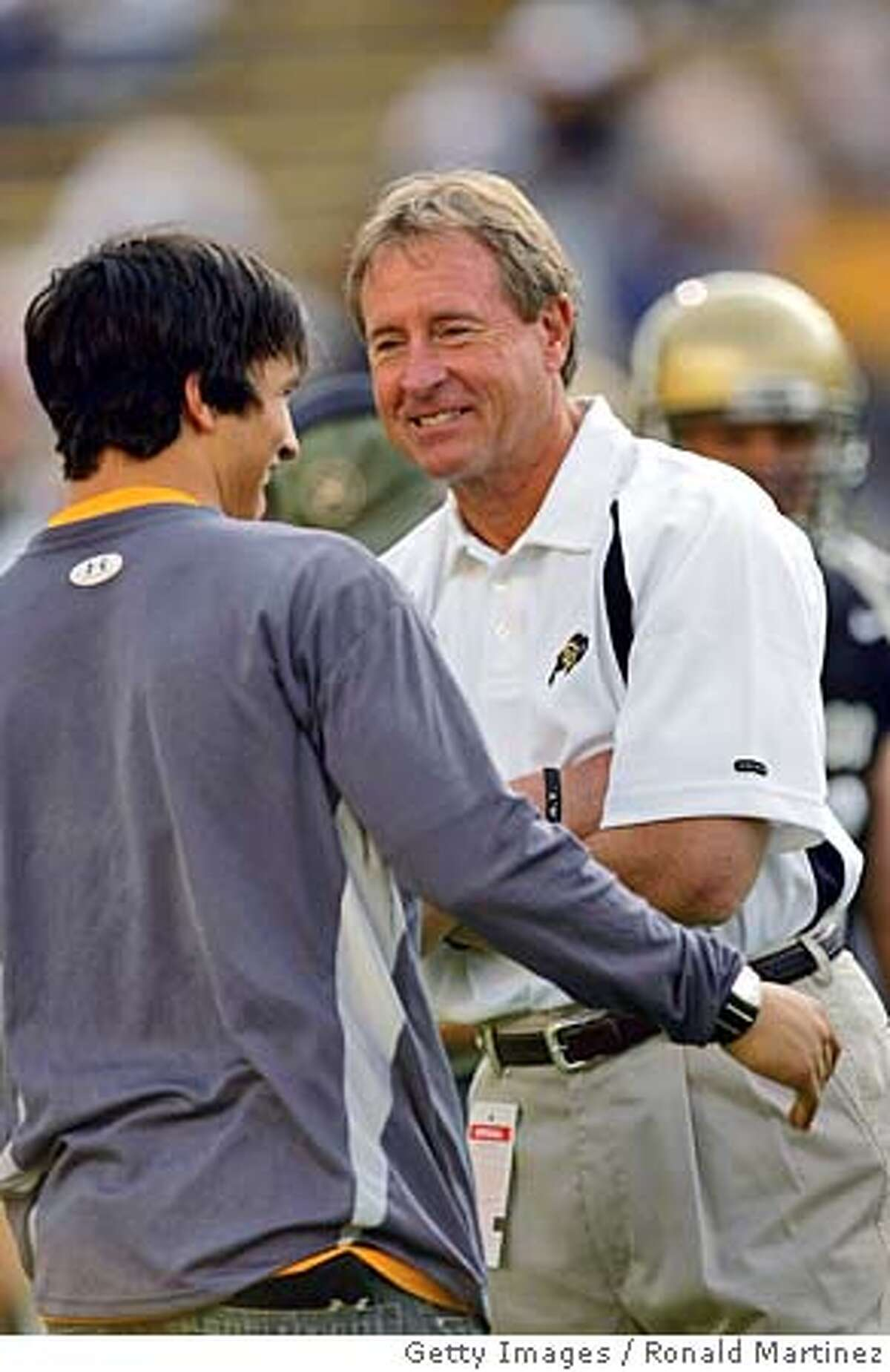 BOULDER, CO - SEPTEMBER 4: Head coach Gary Barnett of the University of Colorado Buffaloes greets former player Jeremy Bloom on September 4, 2004 at Folsom Field in Boulder, Colorado. (Photo by Ronald Martinez/Getty Images) *** Local Caption *** Gary Barnett;Jeremy Bloom