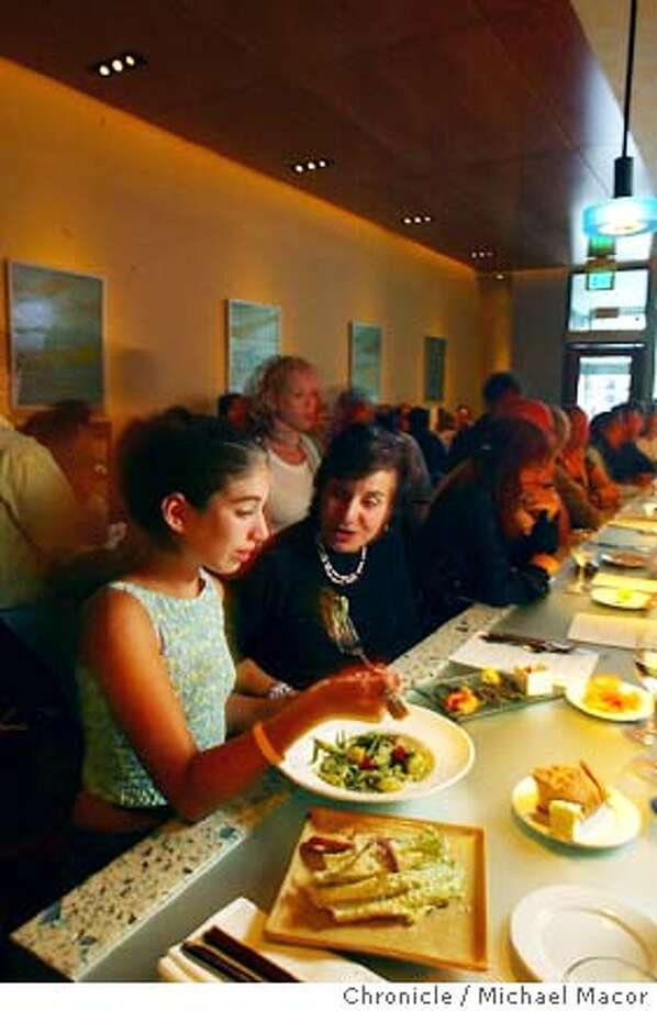 "11 year old Alexis Brandon and her mom Anne of Oakland. Oakland's ""PEARL"" Restaurant on college Ave. featuring Executive chef Mark Lusardi. 8/3/04 in Oakland Michael Macor/San Francisco Chronicle Photo: Michael Macor"