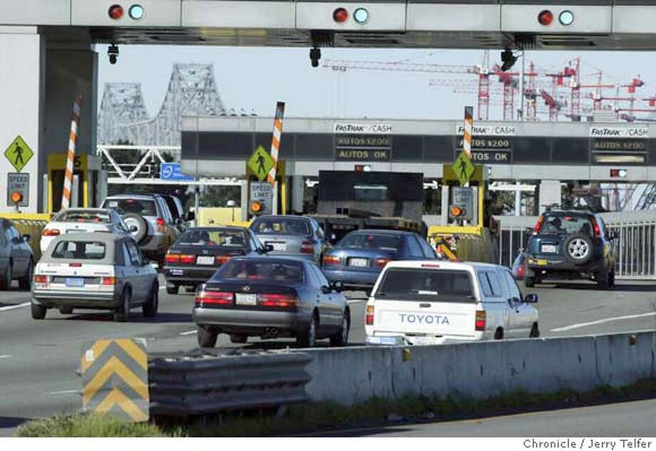 Commuter vehicles pass through the Bay Bridge Toll Plaza on their way to San Francisco. Event on 3/2/04 in Oakland Photo by JERRY TELFER / The Chronicle MANDATORY CREDIT FOR PHOTOG AND SF CHRONICLE/ -MAGS OUT Photo: JERRY TELFER