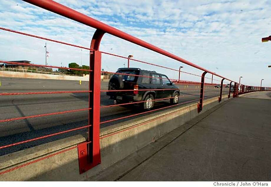 GOLDEN GATE BRIDGE, San Francisco,CA  Bikerails, a newley installed railing, seperating the pedestrian poppulation from vechile traffic on the bridge  photo/John O'hara Photo: JOHN O'HARA