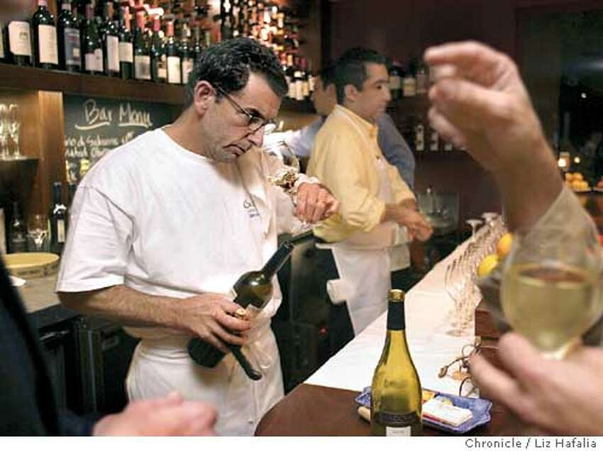 Photos for dining out in magazine for Cucina. Jack Krietzman checking out wine at the bar. Shot on 12/11/03 in San Anselmo. LIZ HAFALIA / The Chronicle