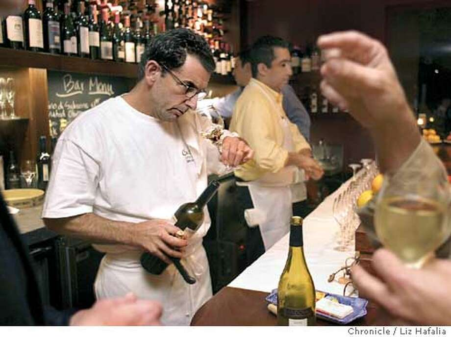 Photos for dining out in magazine for Cucina. Jack Krietzman checking out wine at the bar. Shot on 12/11/03 in San Anselmo. LIZ HAFALIA / The Chronicle Photo: LIZ HAFALIA