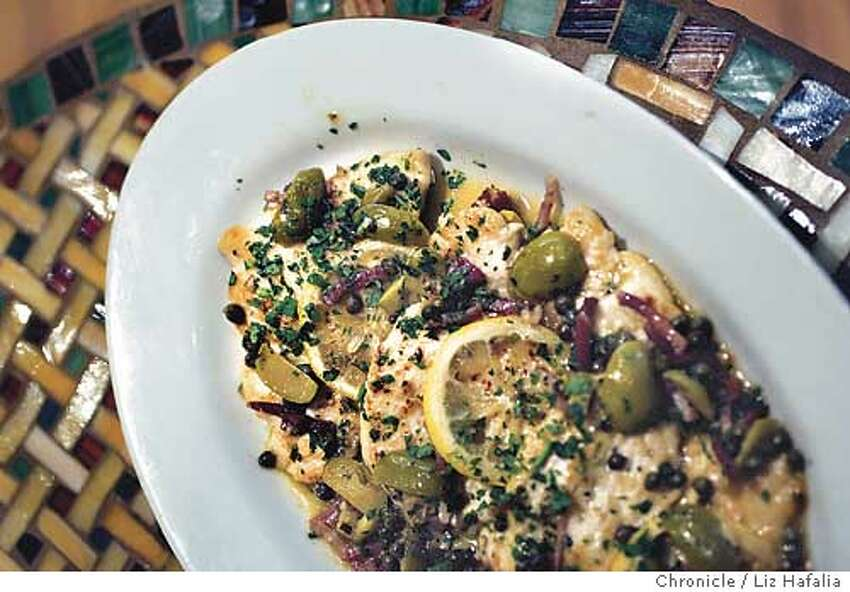 Photos for dining out in magazine for Cucina. Pollo alla Siciliana: boneless breast of chicken sauteed with lemon, capers, prosciutto, olives, garlic, and white wine. Shot on 12/11/03 in San Anselmo. LIZ HAFALIA / The Chronicle