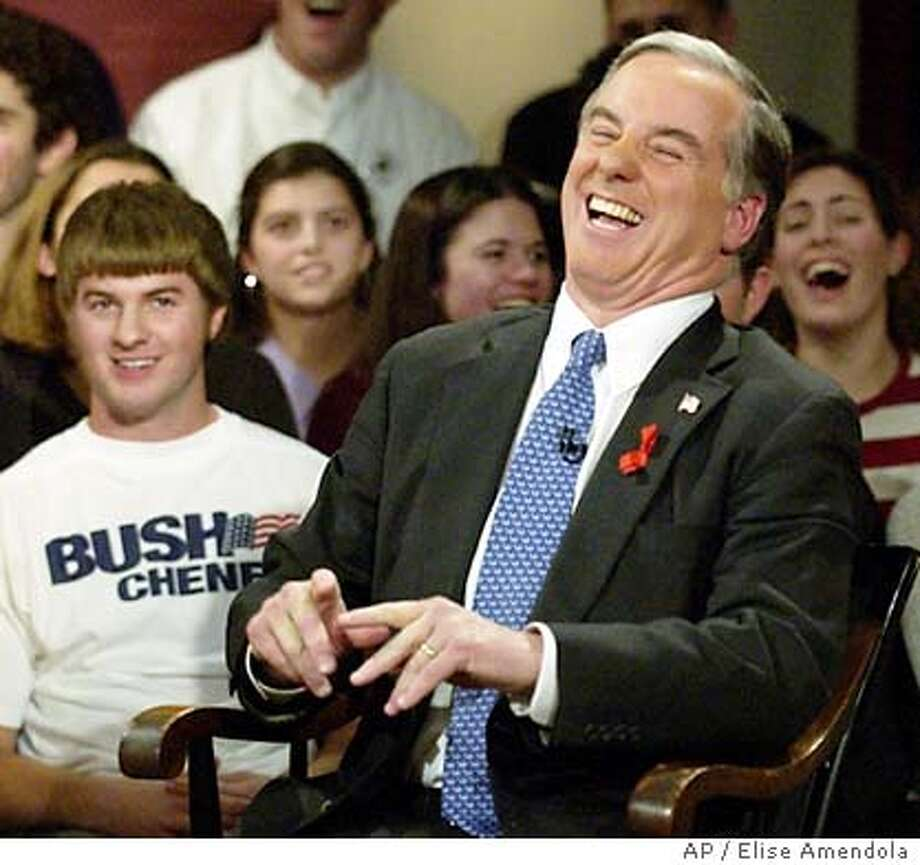 "Democratic presidential candidate Howard Dean laughs after seeing a student wearing a Bush-Cheney campaign T-shirt behind him during a taping of ""Hardball,"" with host Chris Matthews, Monday, Dec. 1, 2003, at Harvard University's Institute of Politics in Cambridge, Mass. (AP Photo/Elise Amendola) Howard Dean: Voters love pooches Photo: ELISE AMENDOLA"