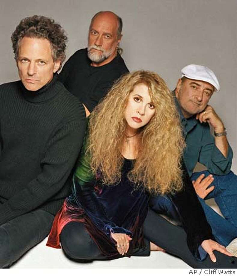 "** ADVANCE FOR WEEKEND EDITIONS MAY 1-4 **The rock group Fleetwood Mac poses together in this undated promotional photo for its new album ""Say You Will,"" its first with new material since 1987. Current members of the band, from left, are, Lindsey Buckingham, Mick Fleetwood, Stevie Nicks and John McVie. (AP Photo/Cliff Watts) ALSO RAN 7/25/03 CAT HFR 05-01-03. ADVANCE FOR WEEKEND EDITIONS MAY 1-4. Photo: CLIFF WATTS"