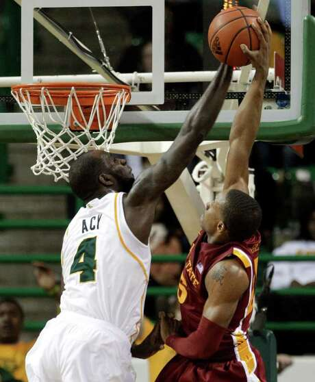 Baylor's Quincy Acy (4) blocks a second-half dunk attempt by Iowa State's Tyrus McGee. Photo: Tony Gutierrez / AP