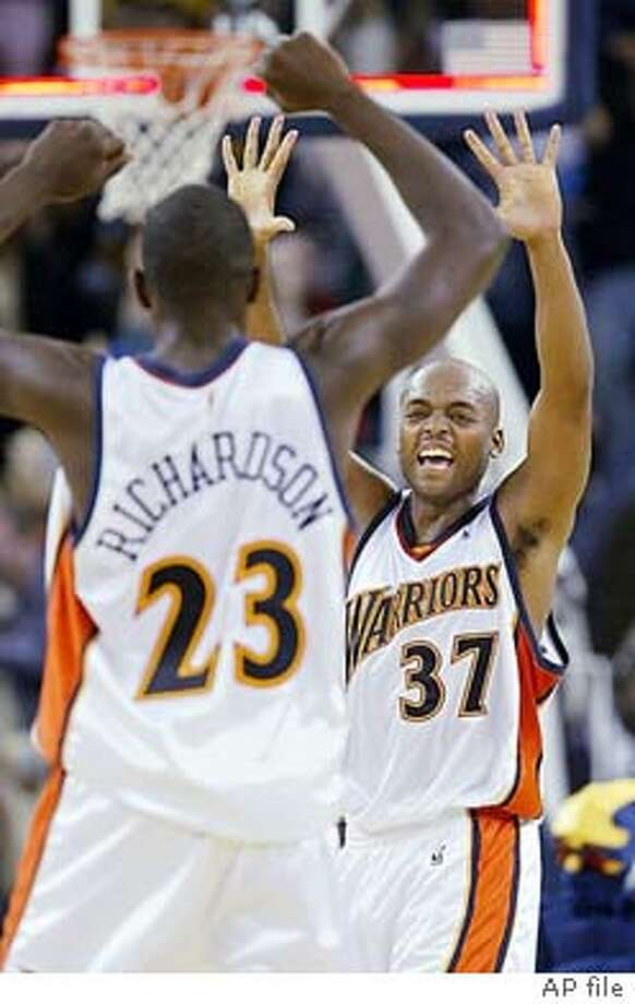 Nick Van Exel, right, and teammate Jason Richardson celebrate as the Golden State Warriors beat the San Antonio Spurs 91-89 in Oakland, Calif., on Saturday, Nov. 29, 2003. Van Exel led all scorers with 29 points. (AP Photo/Jeff Chiu) Nick Van Exel has helped the Warriors develop into a tight-knit unit that's 8-7. Photo: JEFF CHIU