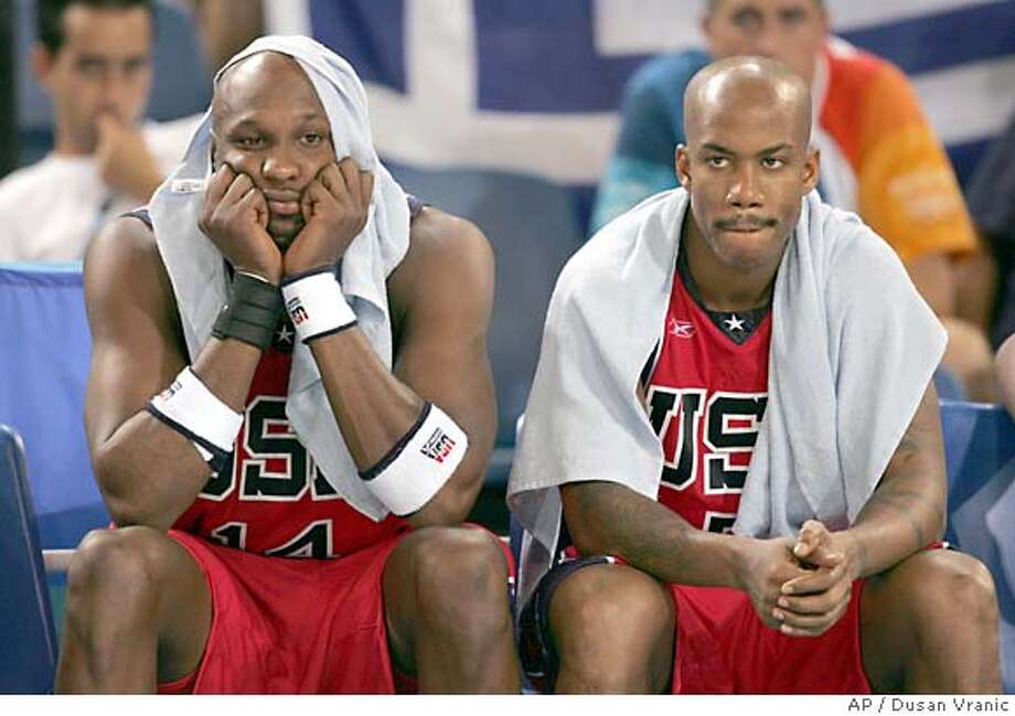 United States players, from left, Lamar Odom and Stephon Marbury sit dejected as their team loses to Puerto Rico during a men's basketball tournament preliminary match against Puerto Rico in Hellinikon on Sunday, Aug. 15, 2004, during 2004 Olympic Games in Athens. Photo: DUSAN VRANIC