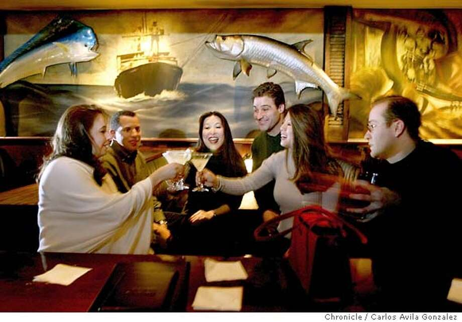 Several patrons enjoy drinks at Habana Yacht Club in San Carlos, Ca., where the theme in both the bar and restaurant is Cuban-inspired. Event on 01/07/03 in San Carlos, Ca. Photo By Carlos Avila Gonzalez / The San Francisco Chronicle Photo: Carlos Avila Gonzalez