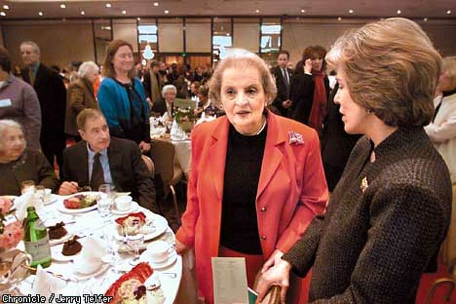 "Featured speaker Madeline Albright, former US Secretary of State, and international drug expert Mathea Falco (right) talk together before Albright addressed ""The Power of Choice"" luncheon in the Grand Ballroom of the St. Francis Hotel on Union Square. Seated at table left is Ray Dolby, head of Dolby Digital.  CHRONICLE STAFF PHOTO BY JERRY TELFER Photo: JERRY TELFER"