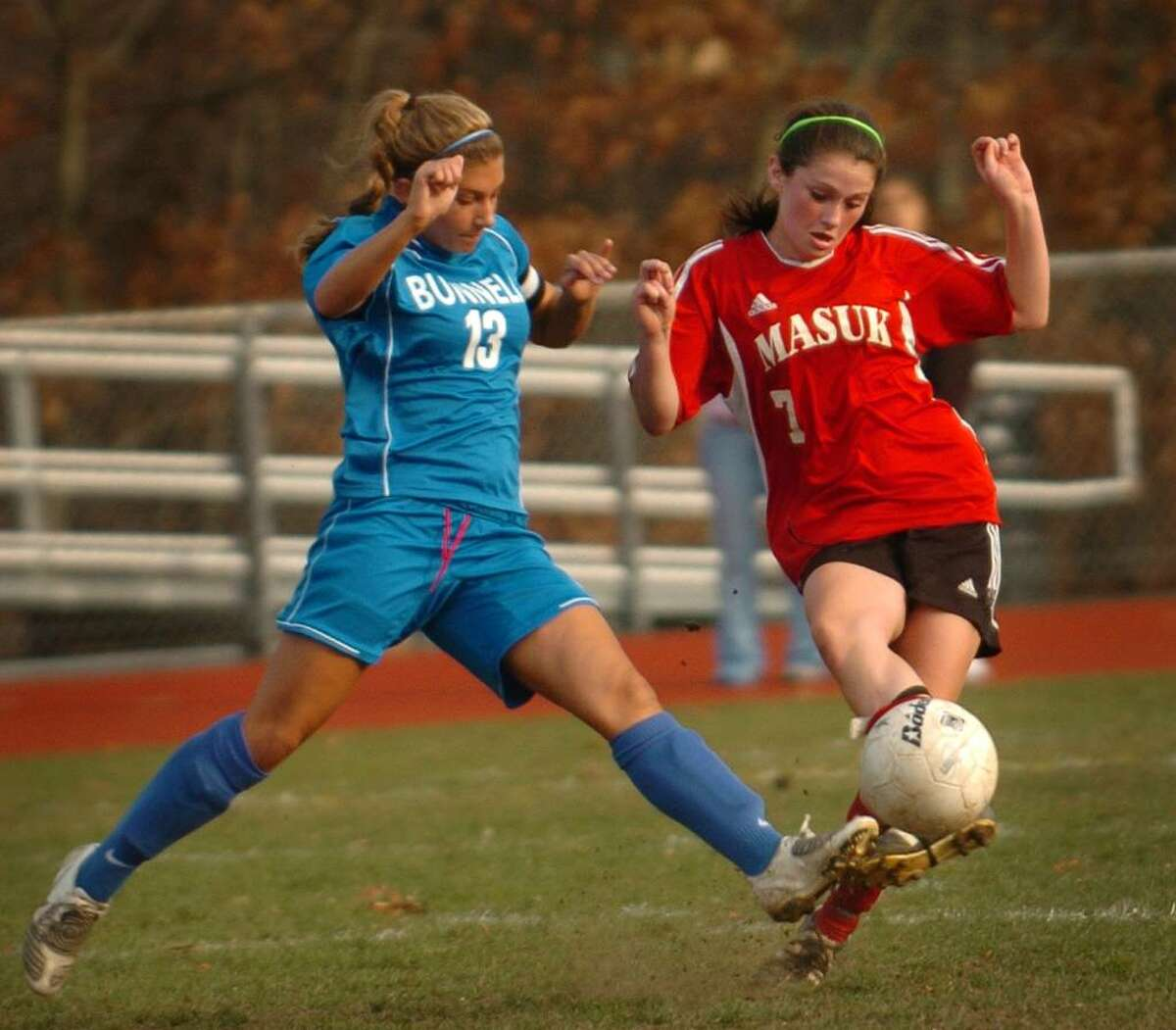 Bunnell's Bridgette Dolio, left, and Masuk's Aislinn McKeown converge on the ball during Monday's matchup in the opening round of the Class L state playoffs.