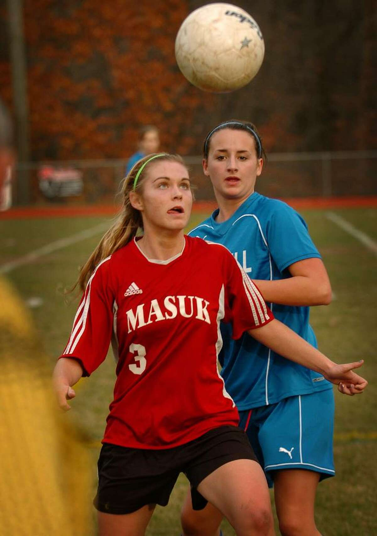 Masuk's Collen Coubren eyes the ball in front of Bunnell defender Megan Murphy during Monday's matchup in the opening round of the Class L state playoffs at Masuk High School in Monroe.