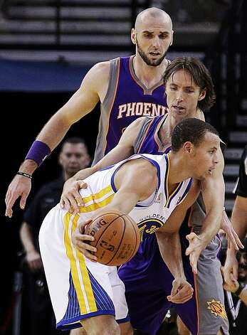 Golden State Warriors' Stephen Curry (30) looks to pass away from Phoenix Suns' Steve Nash, center, and Marcin Gortat during the first half of an NBA basketball game, Monday, Feb. 13, 2012, in Oakland, Calif. (AP Photo/Ben Margot) Photo: Ben Margot, Associated Press