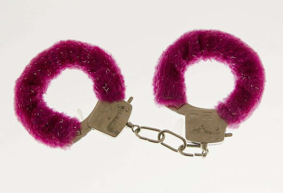 In this photo taken Friday, Feb. 10, 2012, a pair of handcuffs are displayed at the Museum of Broken Relationships in Zagreb, Croatia. The exhibits, collected from all over the world, are random and varied, ranging from fake breasts to a cast from a broken leg. Each item is accompanied by a summary of dates and locations of the relationships, and notes written by their anonymous donors. (AP Photo/Darko Bandic) Photo: Darko Bandic, Associated Press