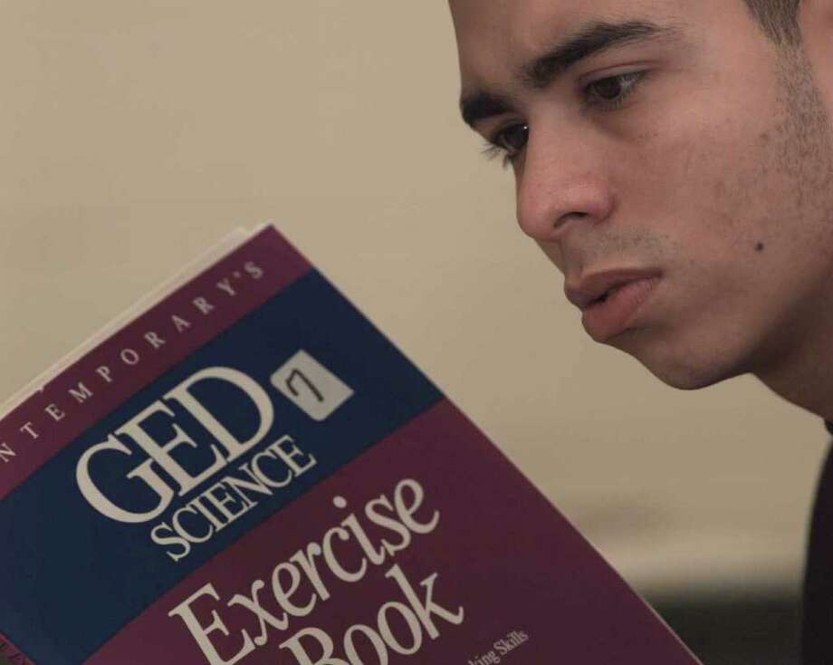 The state is considering alternative pathways to the high school equivalency diploma because the for-profit company that runs and administers the GED test is planning a substantial cost increase. Here, a student is pictured studying for his high school equivalency diploma in a 1995 file photo. (Luanne M. Ferris / Times Union archive) Photo: LUANNE M. FERRIS / ALBANY TIMES UNION