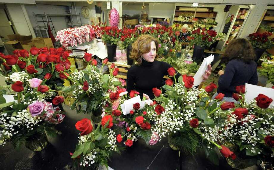 Margie Amodeo prepares outgoing orders at the Emil J. Nagengast Florists in Albany , N.Y.  Feb. 13, 2012 in preparation for Valentines Day.   ( Skip Dickstein/Times Union) Photo: Skip Dickstein