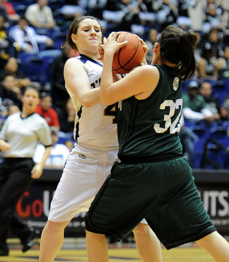 O'Connor's Kristina Schuler (4) battles Southwest's Emilee Martinez (32) for the ball during a UIL 5A girls bidistrict playoff  basketball game between Southwest and O'Connor at the UTSA Convocation Center in San Antonio on Monday, Feb. 13, 2012. Photo: JOHN ALBRIGHT, For The Express-News / Special to the Express-News
