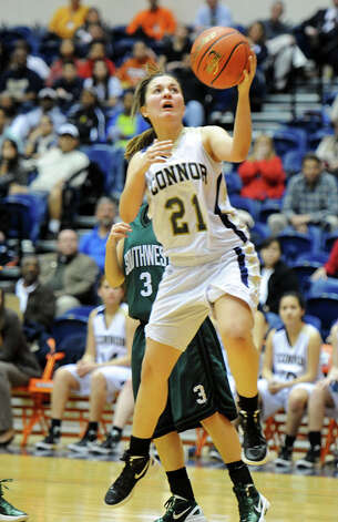 O'Connor's Shalyse Garcia (21) puts up a lay-up during a UIL 5A girls bidistrict playoff  basketball game between Southwest and O'Connor at the UTSA Convocation Center in San Antonio on Monday, Feb. 13, 2012. Photo: JOHN ALBRIGHT, For The Express-News / Special to the Express-News