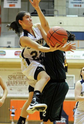 O'Connor's Amber Vidal (22) takes an off-balanced shot from under the basket during a UIL 5A girls bidistrict playoff  basketball game between Southwest and O'Connor at the UTSA Convocation Center in San Antonio on Monday, Feb. 13, 2012. Photo: JOHN ALBRIGHT, For The Express-News / Special to the Express-News