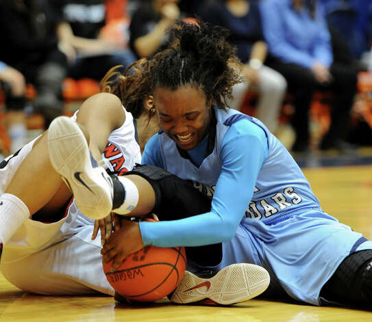 Johnson's Gabbi Bowie battles Wagner's Kaelynn Wilson  for the ball during a UIL 5A girls bidistrict playoff  basketball game between Johnson and Wagner at the UTSA Convocation Center in San Antonio on Monday, Feb. 13, 2012. Photo: JOHN ALBRIGHT, For The Express-News / Special to the Express-News
