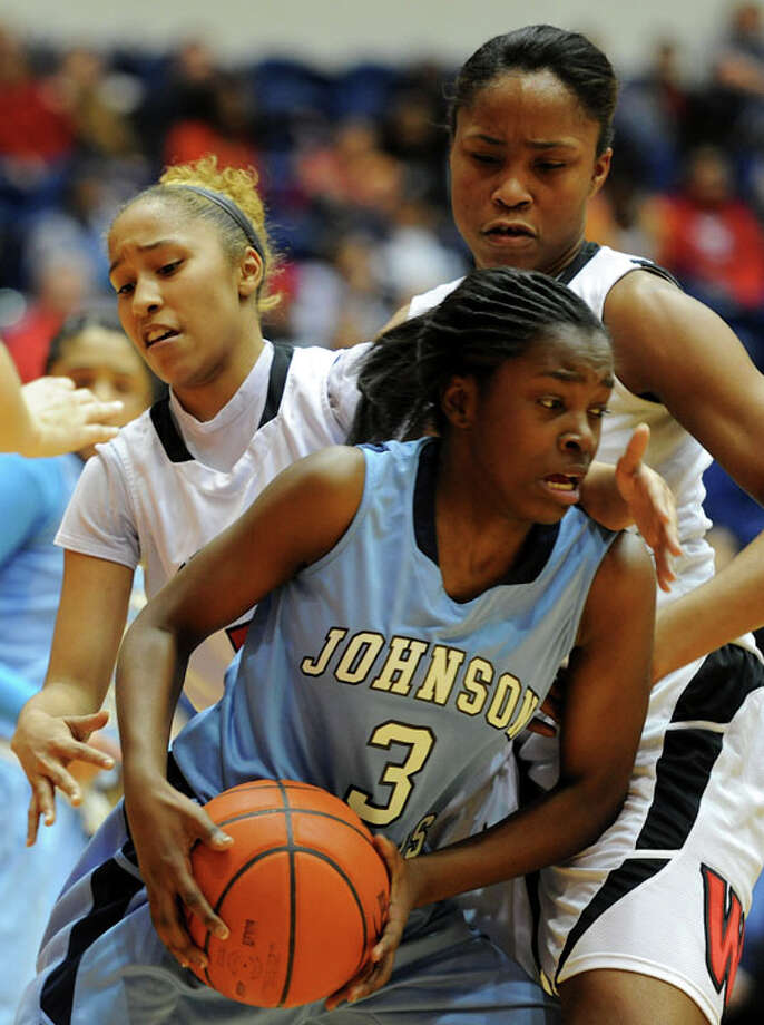 Johnson's Erica Sanders (3) looks for room to dribble as Wagner's Adriane Davis (left) and Tesha Smith (right) close in during a UIL 5A girls bidistrict playoff  basketball game between Johnson and Wagner at the UTSA Convocation Center in San Antonio on Monday, Feb. 13, 2012. Photo: JOHN ALBRIGHT, For The Express-News / Special to the Express-News