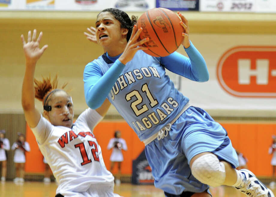 Johnson's Recee Caldwell (21) is fouled by Wagner's Audrea Davis (12) during a UIL 5A girls bidistrict playoff  basketball game between Johnson and Wagner at the UTSA Convocation Center in San Antonio on Monday, Feb. 13, 2012. Photo: JOHN ALBRIGHT, For The Express-News / Special to the Express-News