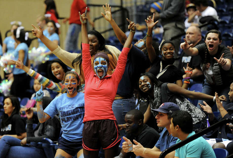Johnson fans celebrate during a UIL 5A girls bidistrict playoff  basketball game between Johnson and Wagner at the UTSA Convocation Center in San Antonio on Monday, Feb. 13, 2012. Photo: JOHN ALBRIGHT, For The Express-News / Special to the Express-News