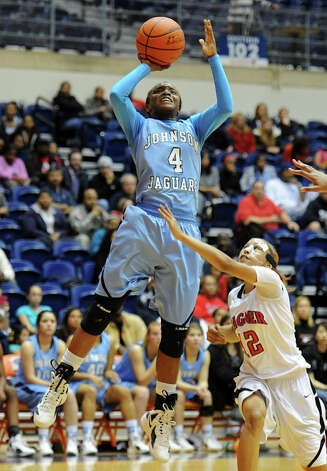 Johnson's Gabbi Bowie (4) takes a shot during a UIL 5A girls bidistrict playoff  basketball game between Johnson and Wagner at the UTSA Convocation Center in San Antonio on Monday, Feb. 13, 2012. Photo: JOHN ALBRIGHT, For The Express-News / Special to the Express-News