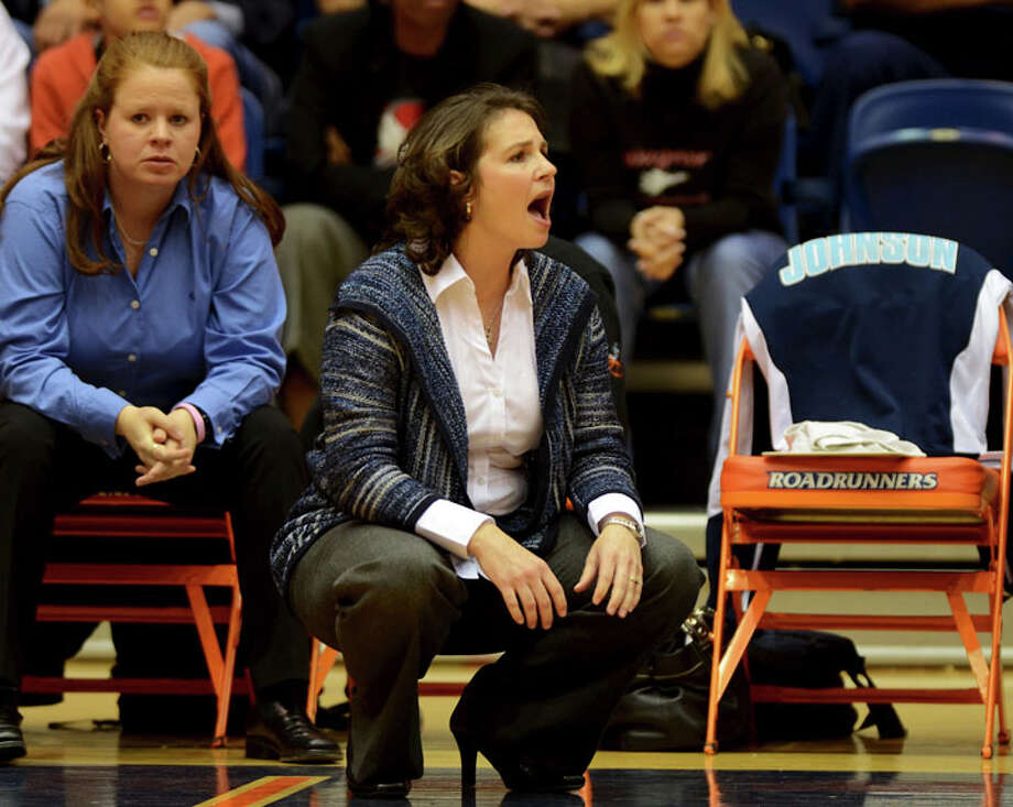 Johnson head coach Audra Bredemeyer yells to her players during a UIL 5A girls bidistrict playoff  basketball game between Johnson and Wagner at the UTSA Convocation Center  in San Antonio on Monday, Feb. 13, 2012. Photo: JOHN ALBRIGHT, For The Express-News / Special to the Express-News