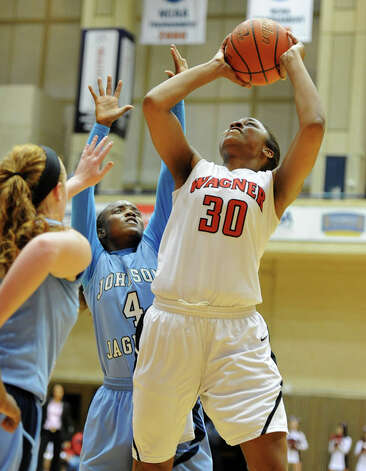 Wagner's Tesha Smith (30) puts up a shot past Johnson's Gabbi Bowie (4) during a UIL 5A girls bidistrict playoff  basketball game between Johnson and Wagner at the UTSA Convocation Center in San Antonio on Monday, Feb. 13, 2012. Photo: JOHN ALBRIGHT, For The Express-News / Special to the Express-News