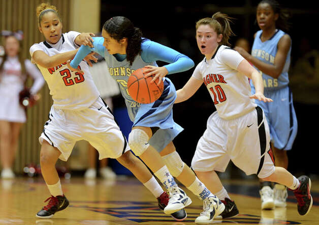 Johnson's Recee Caldwell (21) is double teamed by Wagner's Adriane Davis (23) and Corrina Moncada (10) during a UIL 5A girls bidistrict playoff  basketball game between Johnson and Wagner at the UTSA Convocation Center in San Antonio on Monday, Feb. 13, 2012. Photo: JOHN ALBRIGHT, For The Express-News / Special to the Express-News