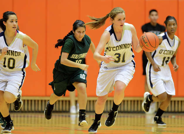 O'Connor's Shelbi Miller (31) brings the ball up court on a fast break during a UIL 5A girls bidistrict playoff  basketball game between Southwest and O'Connor at the UTSA Convocation Center in San Antonio on Monday, Feb. 13, 2012. Photo: JOHN ALBRIGHT, For The Express-News / Special to the Express-News