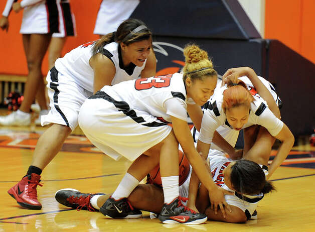 Wagner players converge on teammate Tesha Smith after she broke up an inbounds pass at the end of the second overtime to seal the T-birds' Class 5A bidistrict win over Johnson. Photo: JOHN ALBRIGHT, For The Express-News / Special to the Express-News