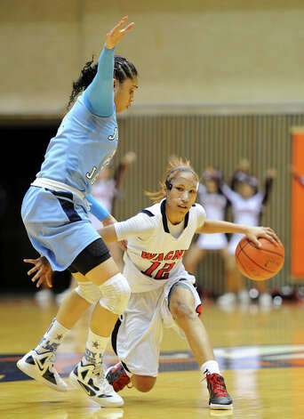 Wagner's Aundrea Davis (12) tries to get past Johnson's Recee Caldwell (21) during a UIL 5A girls bidistrict playoff  basketball game between Johnson and Wagner at the UTSA Convocation Center in San Antonio on Monday, Feb. 13, 2012. Photo: JOHN ALBRIGHT, For The Express-News / Special to the Express-News