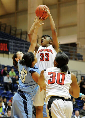Wagner's Kaelynn Wilson (33) puts up a shot during a UIL 5A girls bidistrict playoff  basketball game between Johnson and Wagner at the UTSA Convocation Center in San Antonio on Monday, Feb. 13, 2012. Photo: JOHN ALBRIGHT, For The Express-News / Special to the Express-News