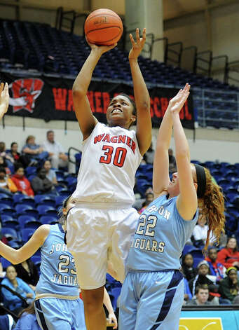 Wagner's Tesha Smith (30) takes a shot during a UIL 5A girls bidistrict playoff  basketball game between Johnson and Wagner at the UTSA Convocation Center in San Antonio on Monday, Feb. 13, 2012. Photo: JOHN ALBRIGHT, For The Express-News / Special to the Express-News