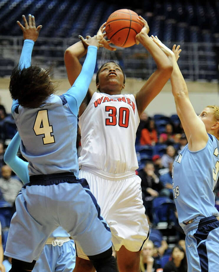 Wagner's Tesha Smith (30) is fouled by Johnson's Gabbi Bowie (4) and Morgan Stearns (32) as she takes a shot during a UIL 5A girls bidistrict playoff  basketball game between Johnson and Wagner at the UTSA Convocation Center in San Antonio on Monday, Feb. 13, 2012. Photo: JOHN ALBRIGHT, For The Express-News / Special to the Express-News